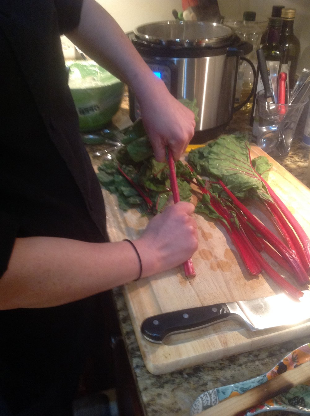 Chef's Greens Cooking Tip: Use your hands to strip off the chard leaves from the stalks. Both parts are edible, but the stalks take longer to cook. They add a nice color and sweetness to this healthy soup