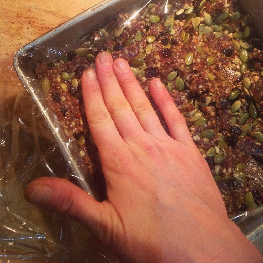 Use your fingers to spread the mixture and press it into a single, even layer.  If the mixture sticks to your fingers, simply get your fingers wet with a little bit of water to prevent more sticking.