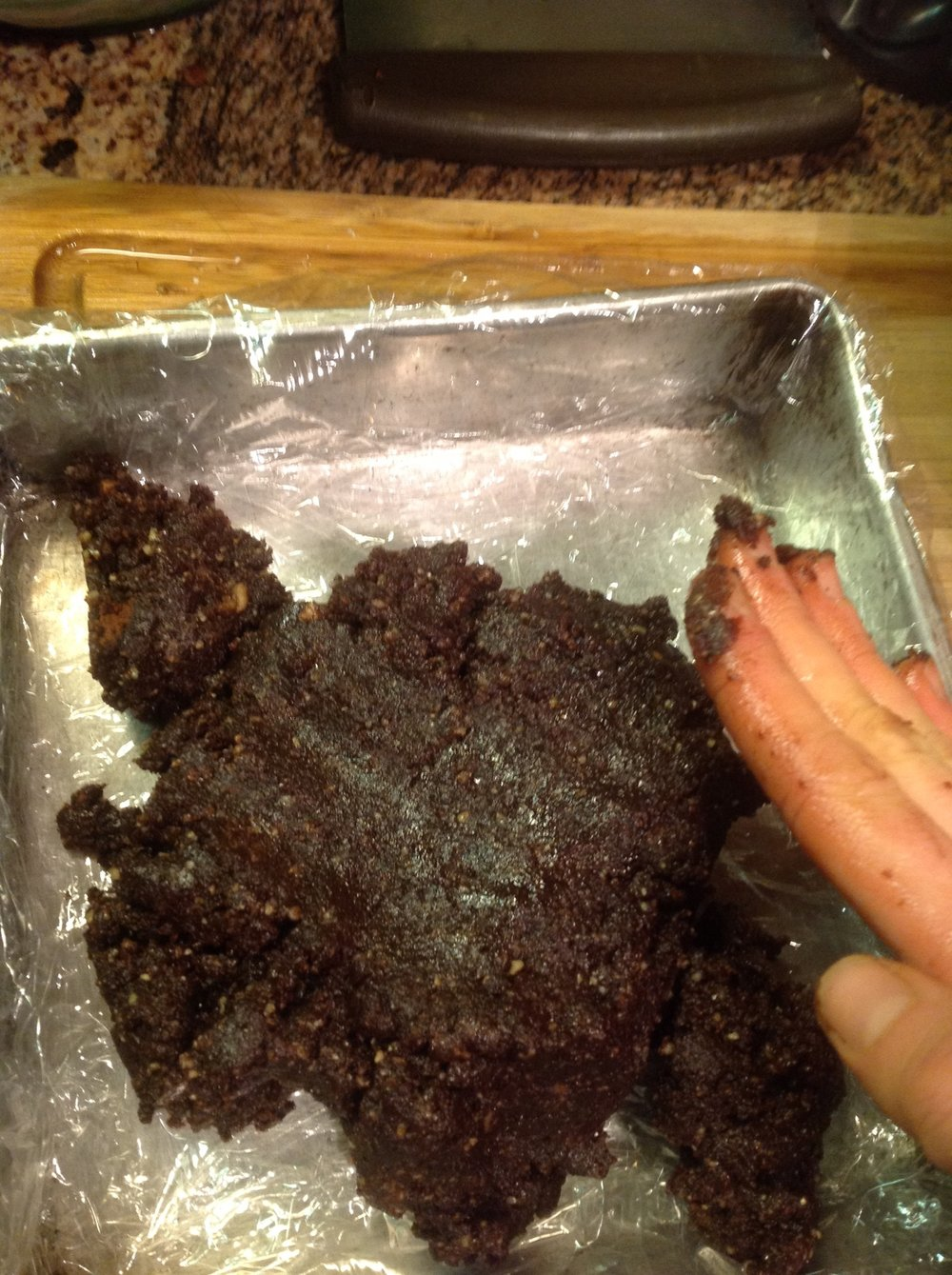 "Press your mixture into a square pan lined with plastic wrap to make brownies.  If you want to enjoy these as ""energy balls"" or as chocolate chunks over Banana ""Nice"" cream, you can roll them into small bites"