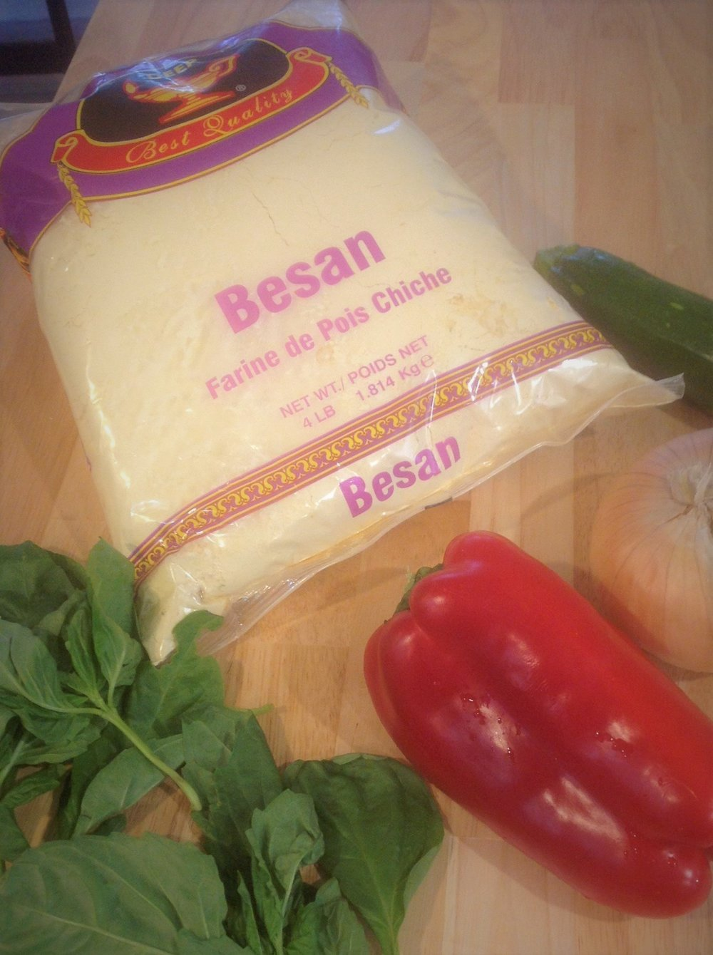 Basan flour (aka chickpea or garbanzo bean) flour can be found in Indian markets.  This gluten-free flour is full of healthy, plant-based vegan protein and fiber