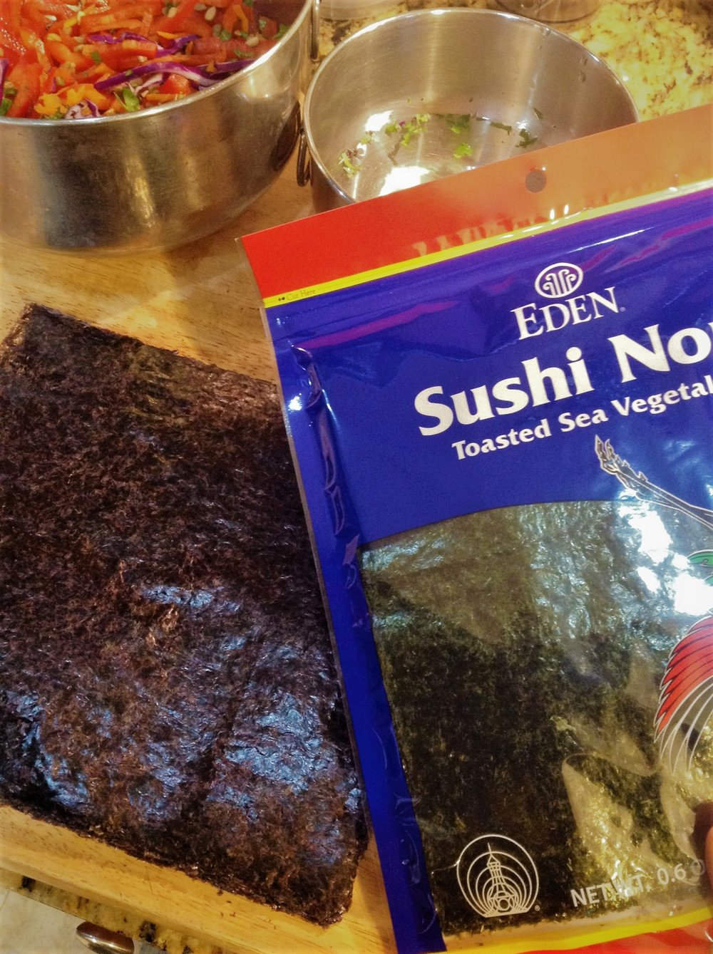 Nori is dried seaweed sheets, often used to make maki sushi rolls.  It comes in Toasted or Untoasted.  For true Raw, choose untoasted sheets