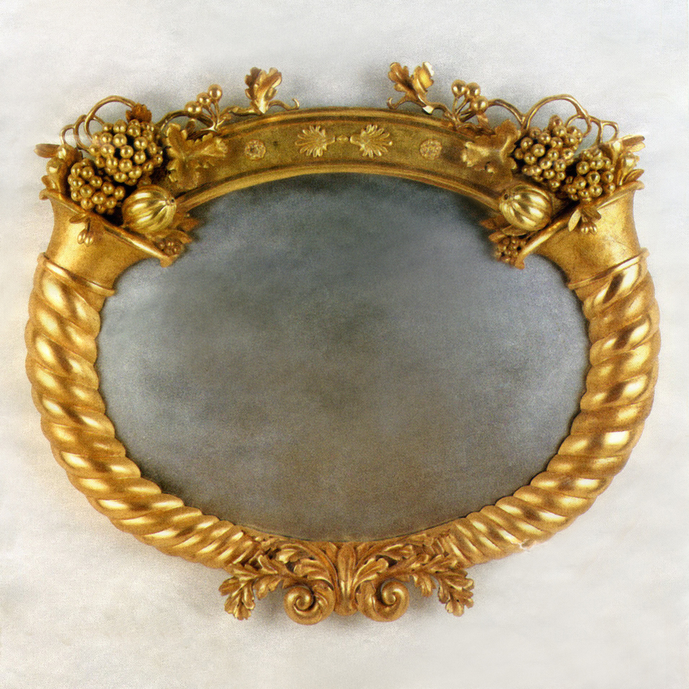 Cornucopia mirror reassembled after restoration.