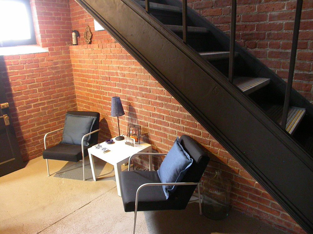 Above: Seating in Lower Lever Lounge area, that is available to tenant. Right: Second view of available office space.