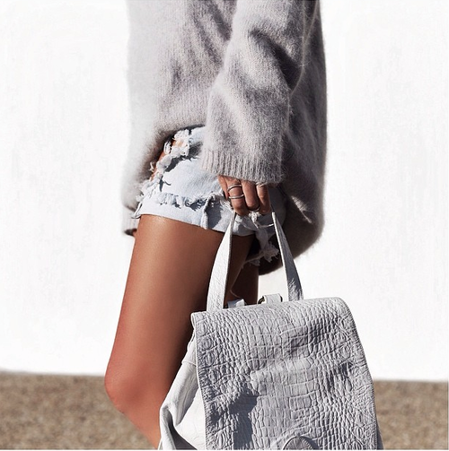 With such a neutral pallet it's smart to add texture to a monochromatic outfit. Note the fuzzy sweater, distressed denim, and crocodile embossed leather backpack!
