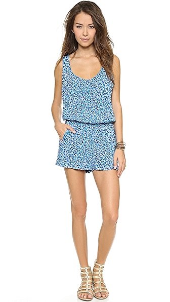 Splendid African Wildflower Romper, $138. The print creates distraction and the waistband covers extra curves.