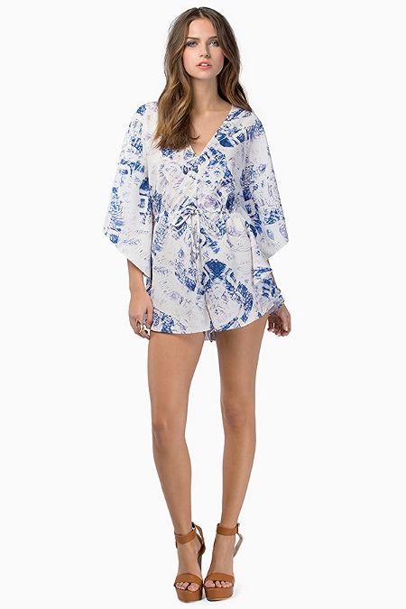 Bless'ed are the Meek Poison Romper, $180. The key for us girls with a bigger booty and/or thighs ( myself included), is to have shorts or bottoms that do not HUG the leg or butt... this piece skims and flows over the models legs creating space between. This is ultra flattering for those with a larger bottom half.