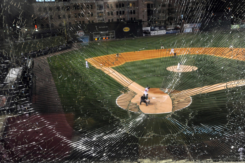 A baseball shatters the press box window as the Greenville Drive hosted the Greensboro Grasshopper at Fluor Field.