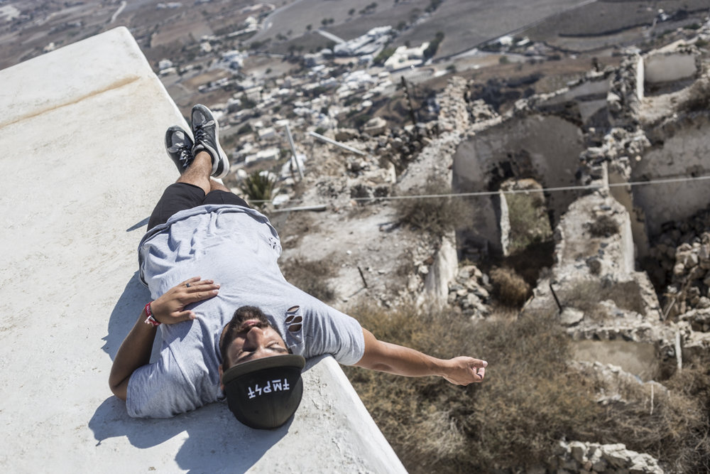 Gabe Nunez taking a nap on top of a church in Pyrgos.