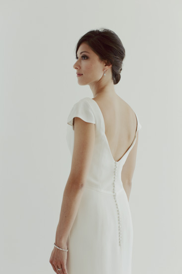 Fabric covered buttons add polish to the back of the  Charlotte  wedding dress.
