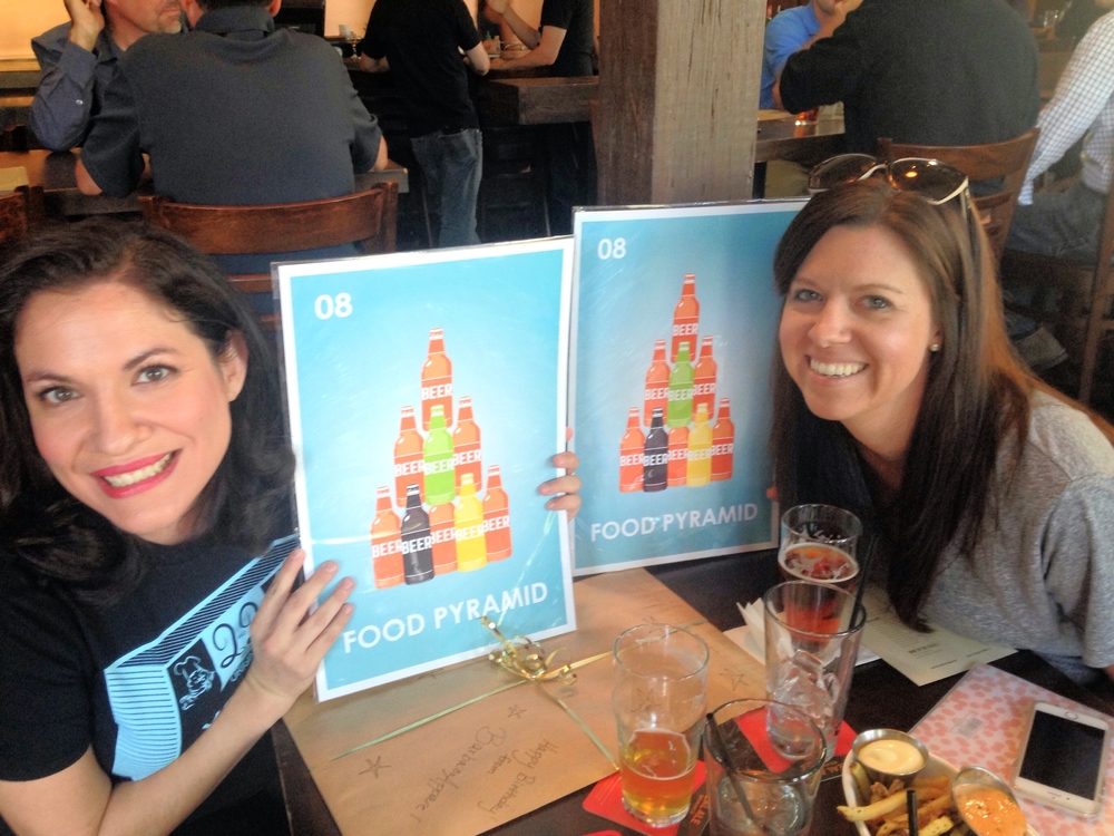 Catherine (left) and Brandi (right) holding BarbacoApparel's latest beer-friendly print