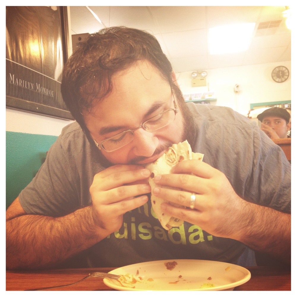 Matt chows down on a carne guisada taco.