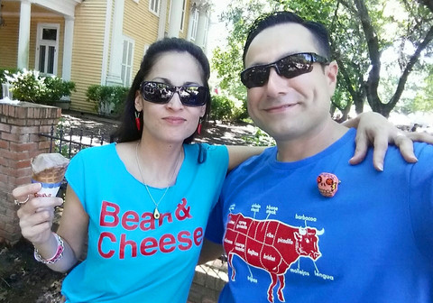 Roseann Sanchez and Mario Siller of Karma Candle Makers pose in their BarbacoApparel tees and Sweet Craft jewelry at the 2015 King William Fair.