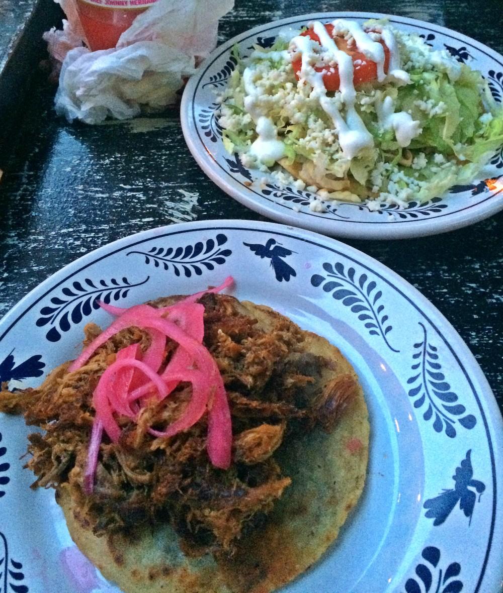A cochinita pibil (front) and pollo en escabeche at La Gloria. (Photo: Barbacoapparel archive.)