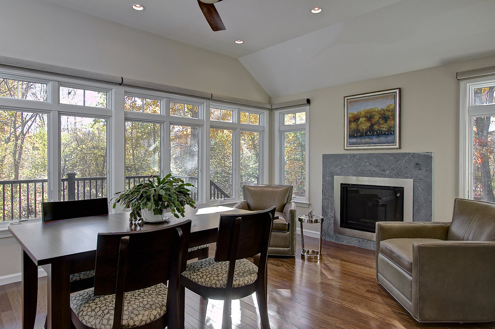 5-KitchenVisions-Other-Spaces-Sunroom-soapstone-gas-fireplace-Westwood.jpg