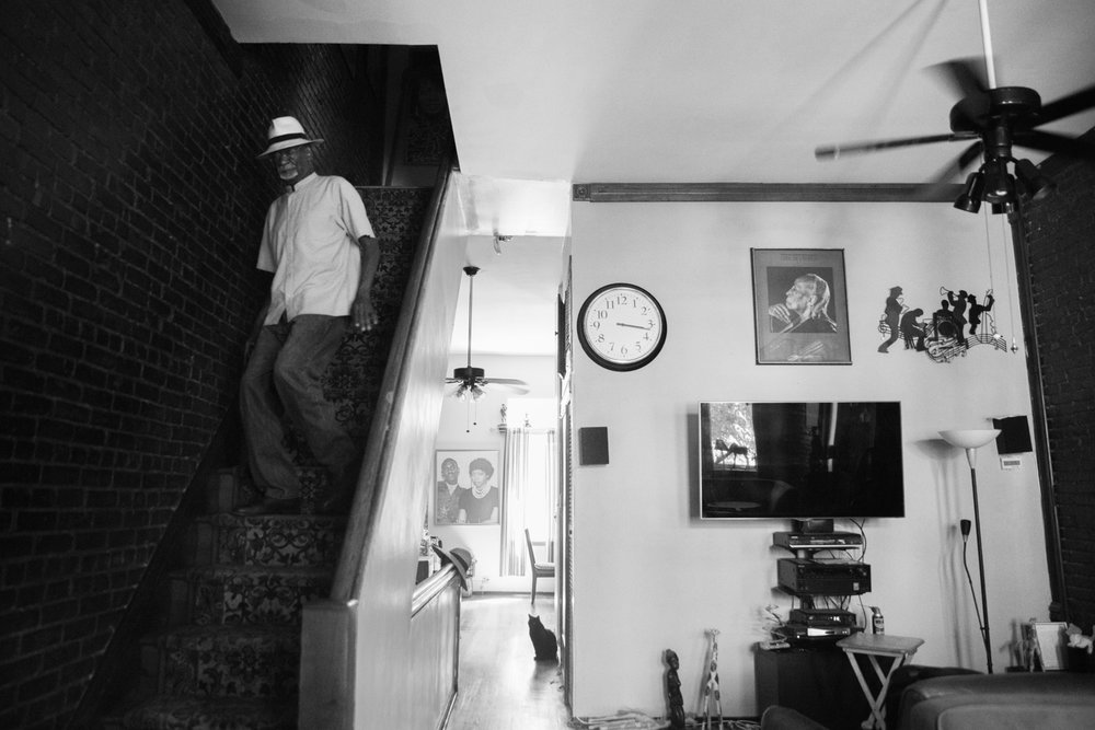 "Luther Gales descends the stairs of his home to head to youth swim practice on June 27, 2017. Gales was born and raised in Harlem. He started teaching youths to swim by teaching his own kids. ""My children were the hardest ones to teach,"" he recalled."