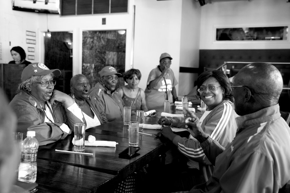 Members of the Harlem Honeys and Bears reminisce together while at a farewell brunch for one of their members on June 28, 2017.