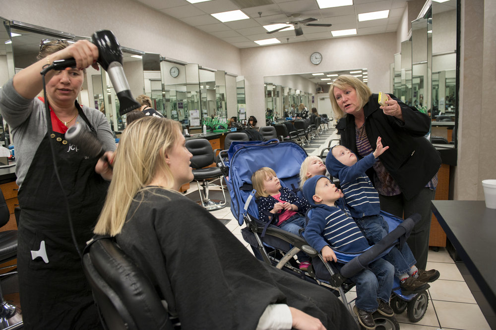 Courtney receives a haircut in the Marketplace Mall  as her mother, Jodi entertains the quadruplets  on Nov. 17, 2015. It is rare that Courtney has time for herself and often needs to bring someone along to help occupy the kids when she does.
