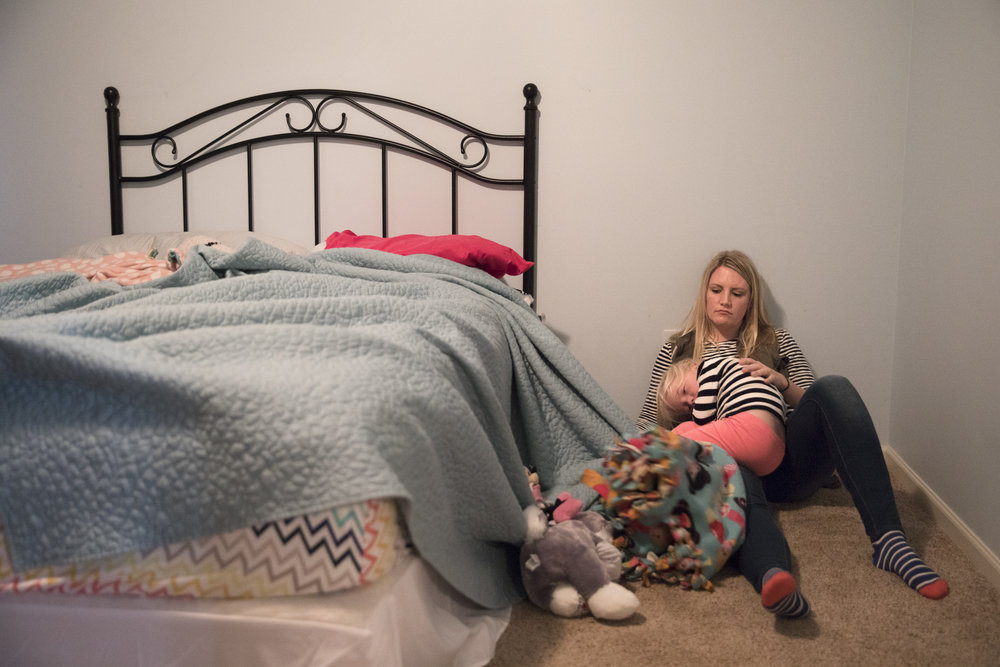 Courtney sits with Ashlyn after waking her up from a nap on Oct. 23, 2016. Courtney walked in to Ashlyn sleeping on the floor covered in blankets and cried when her mom woke her up.