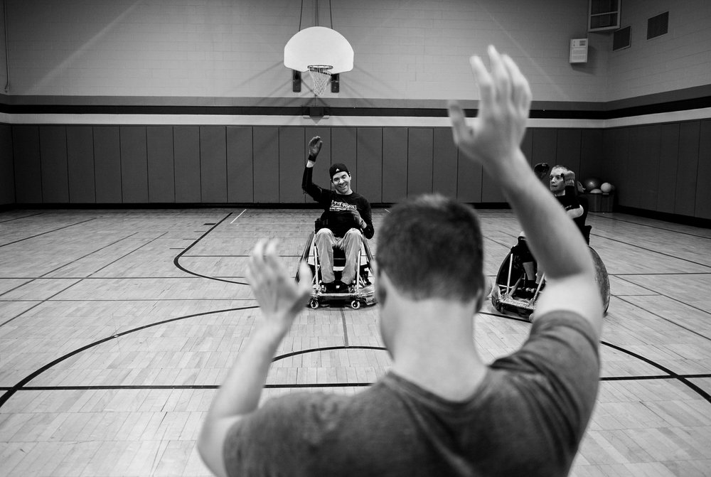 David warms up with his disability rugby team, the Western New York Wreckers during practice. The team is much more than a game for the teammates; it's a support system where everyone understands what it's like to be a quadriplegic.