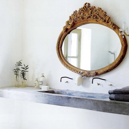 How incredible is this antique mirror combined with a concrete trough sink?? [Via Dwell with Dignity]