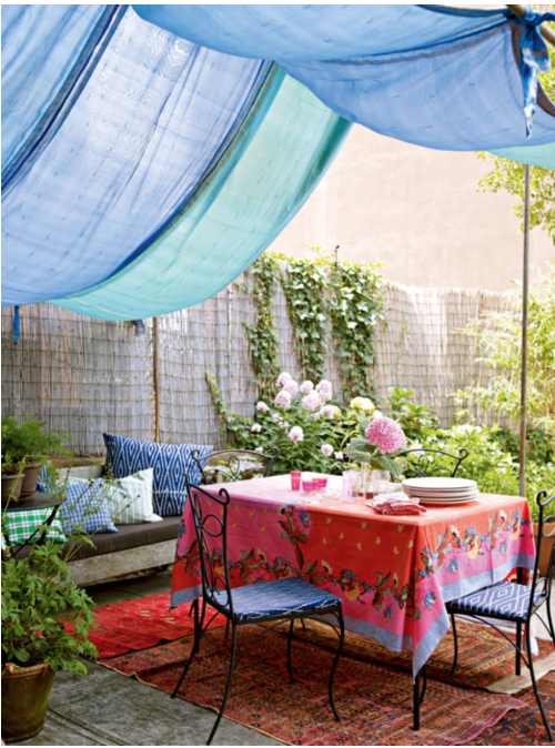 Love the use of a canopy instead of the typical umbrella and the area rugs really make the space feel cozy.  {Via  Houzz }