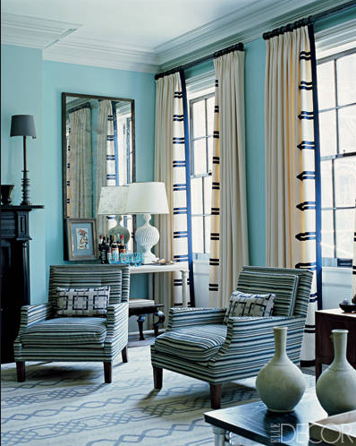 Love the decorative ribbon added to these panels. Simple white panels go from blah to wow. Via Elle Decor.