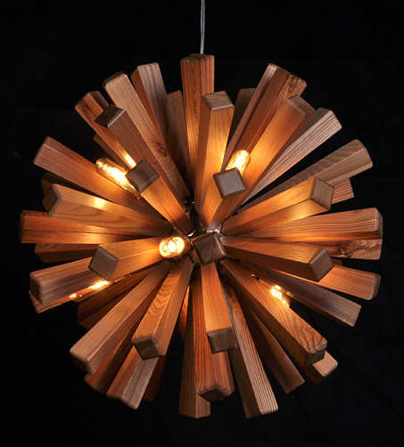 A starburst pendent light made of wood! Such an awesome use of wood. A fixture like this in an entry way would be perfect. { Via Etsy:     industlamp }