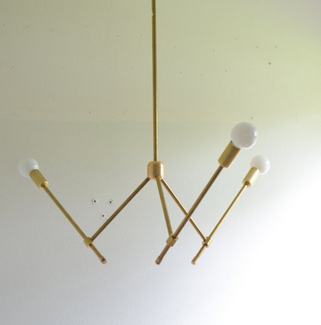 "I have always enjoyed light fixtures that have strong architectural lines and a mid-century modern feel. This fixture reminds me of the classic ""Sputnik"". I could see this over a kitchen table or in a stairway. { Via Etsy:   triple7recycled }"