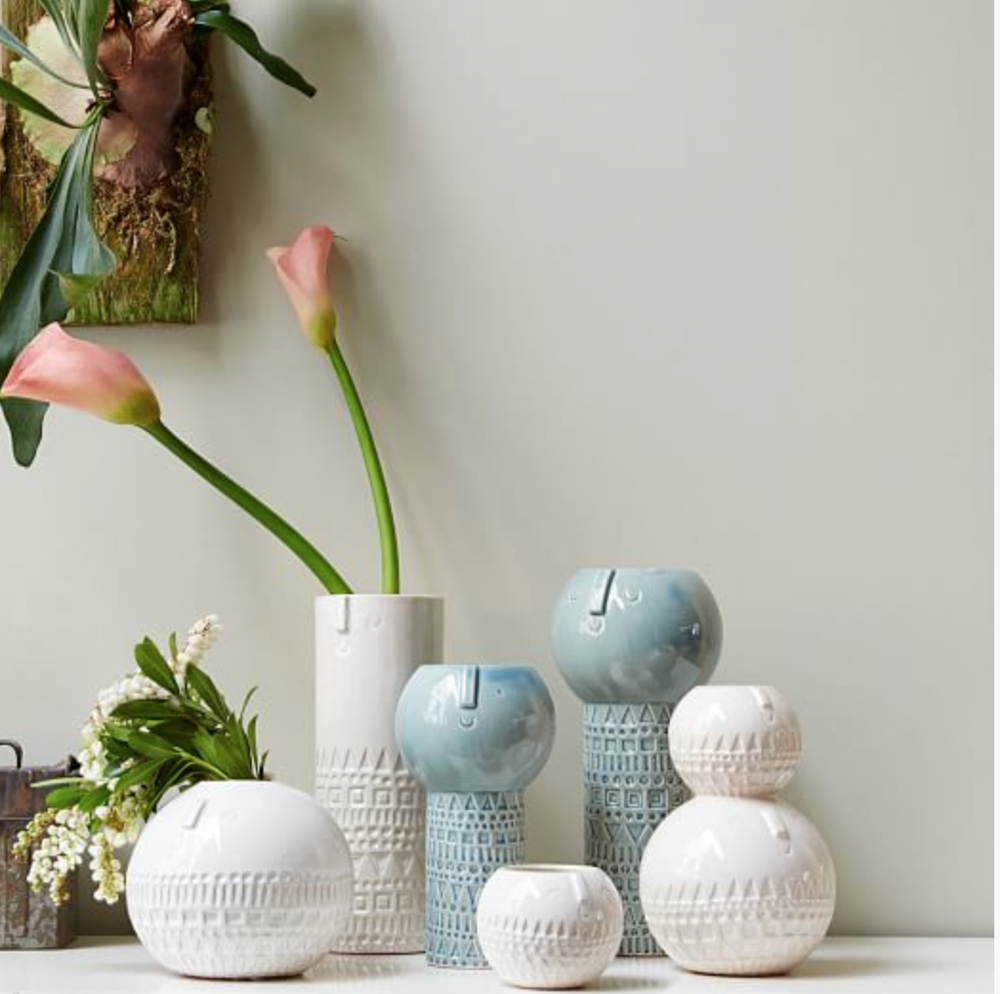 Designed by a London based designer and made and glazed in Portugal.  I love these quirky vases!  Atelier Stella Vases .