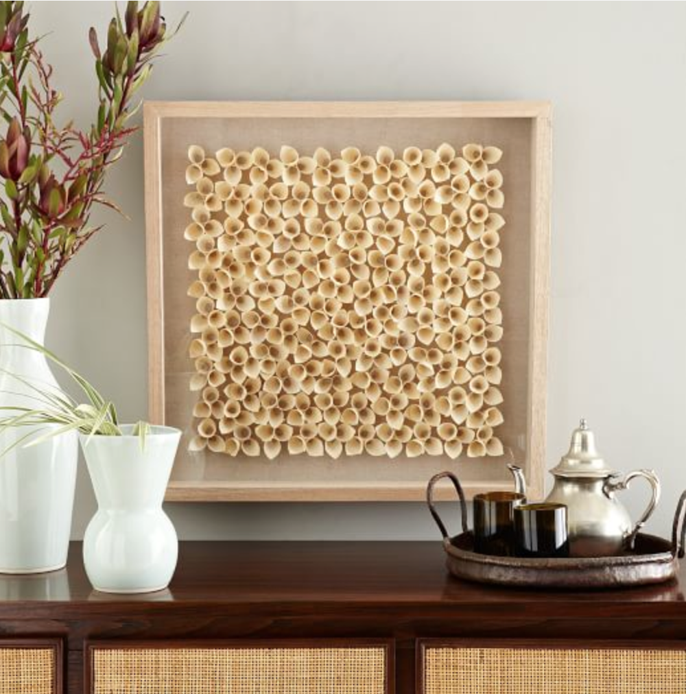 A beautiful work of   art  made in the Philippines, this piece would bring a lovely organic element to any space.