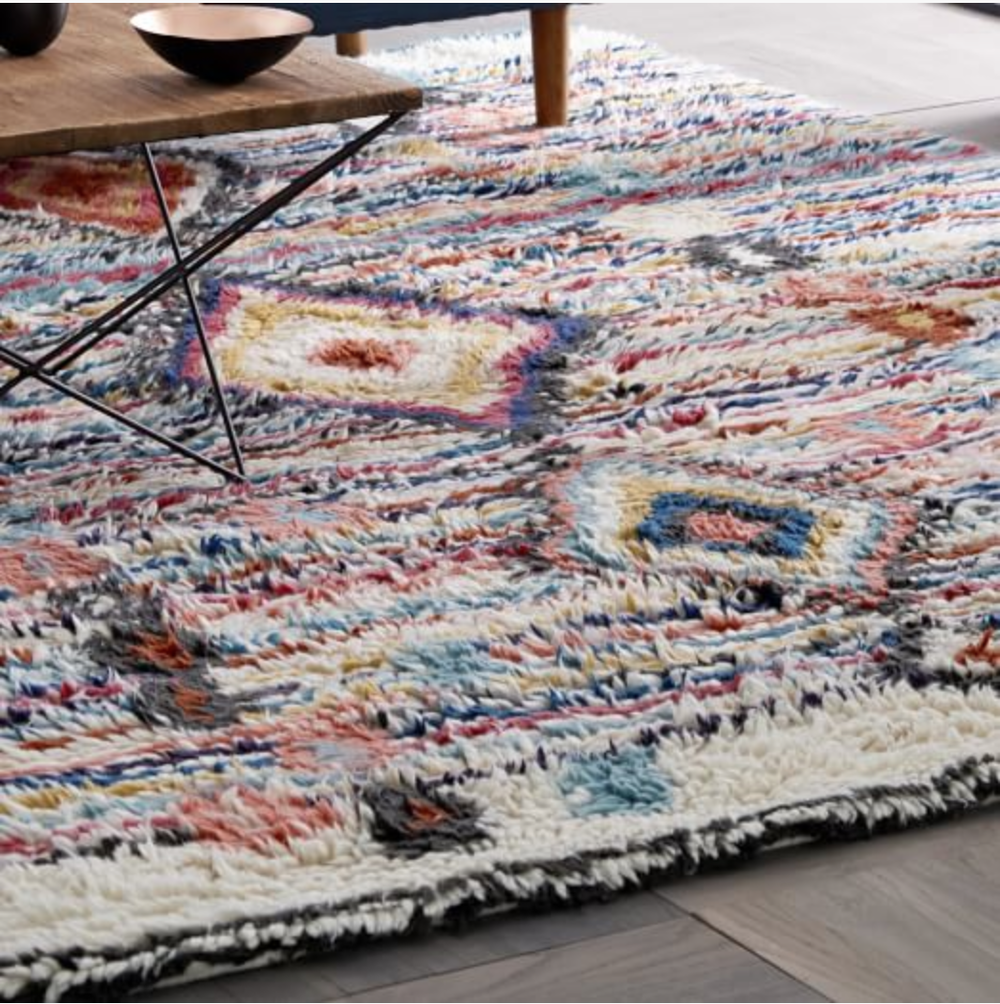 I love the palette in this handcrafted  Charm Wool Rug .