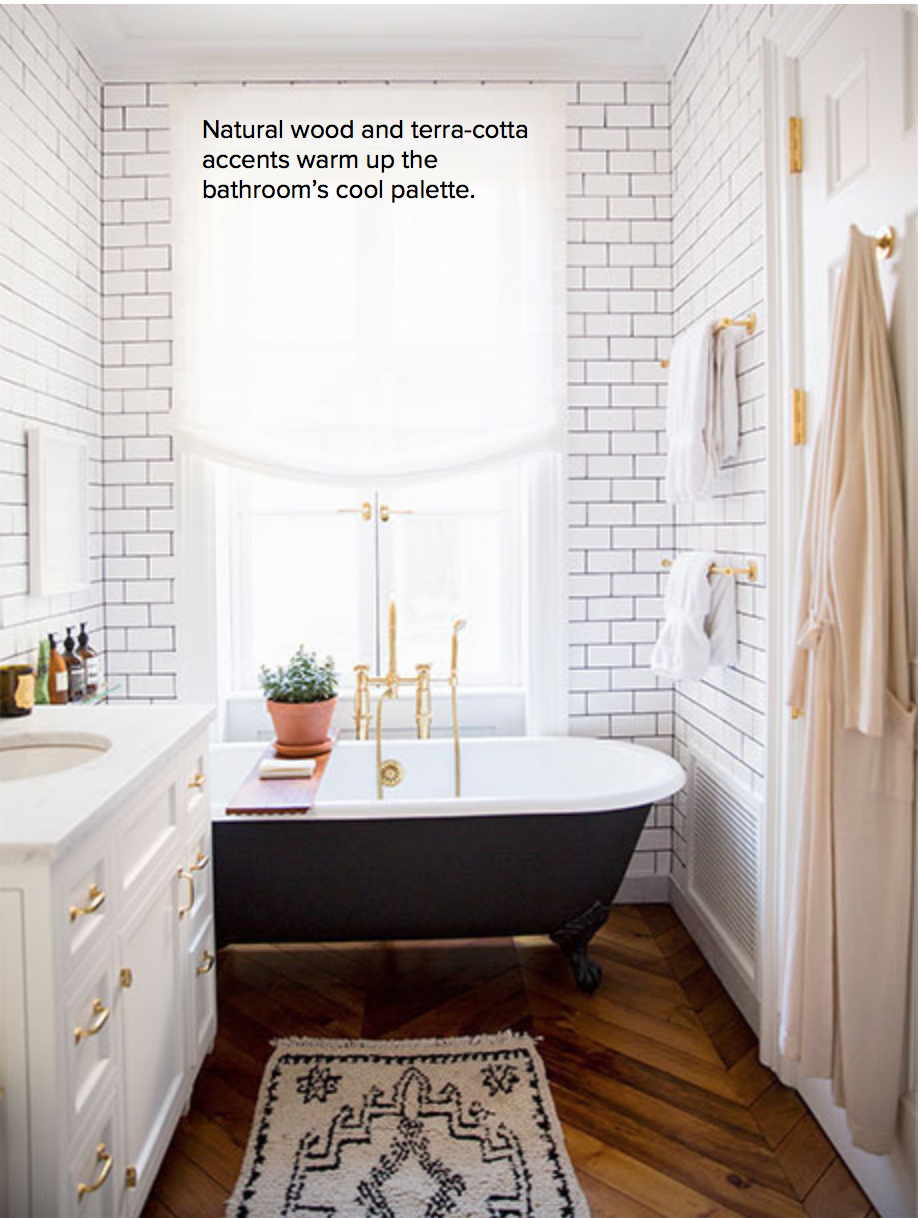 I love the darker grout and the use of the brass hardware.  The black tub is also awesome!  And that rug adds such a cozy element. There's no way we could have wood floors in the bathroom, though.  They'd be destroyed in no time.  The wood has to come in another way...{Via  Domino }