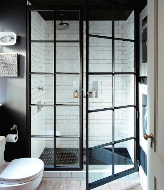 This custom made steel shower door is gorgeous! {Via  Apartment Therapy}