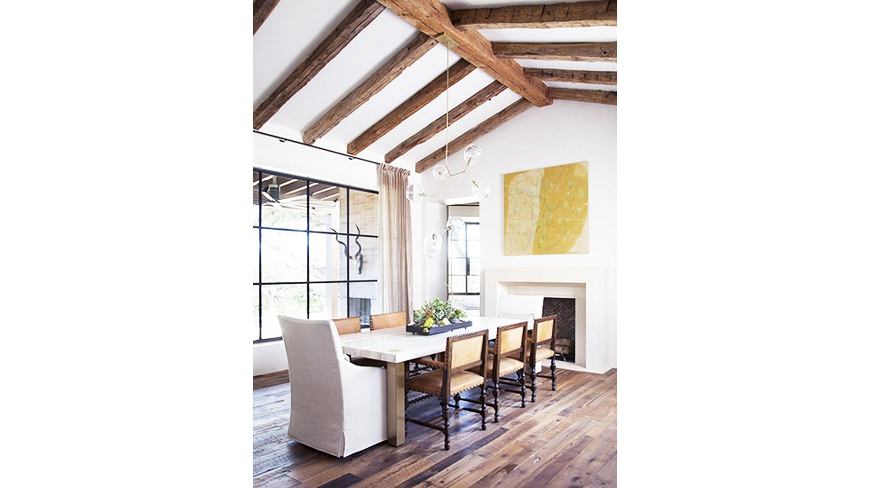 The ceiling is the showstopper. Love the juxtaposition of the rustic beams with the modern light fixture. {Via Domaine Home}