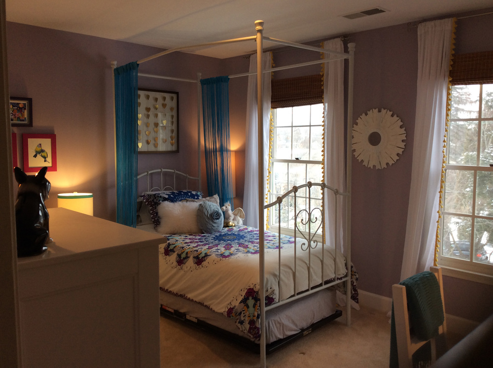We love the bedding with the blue string curtains for her canopy bed.  Perfect for a newly minted teenager!