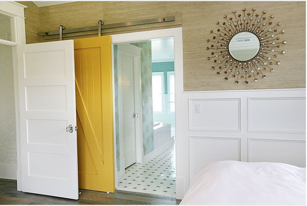 I LOVE this yellow barn door! It's perfect. {Via Houzz.}