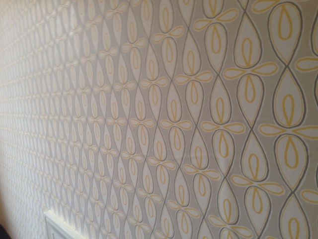 The soft yellow in this wallpaper was threaded through the rest of our client's bedroom with a few choice yellow accents.  Reveal pictures coming soon!