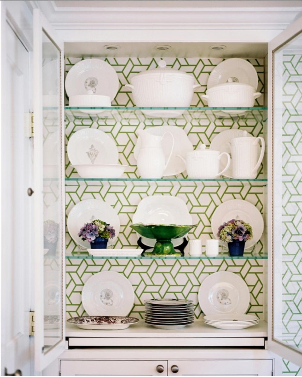 This patterned green and white wallpaper really elevates this china cabinet and makes this classic white china sparkle.  {Via Pinterest}