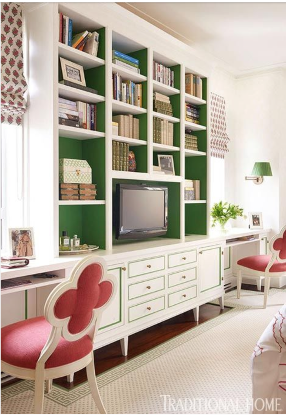 This kelley green on the back of these bookshelves is perfect and it really highlights the detail on the cabinet and drawer fronts!  {Via Traditional Home}