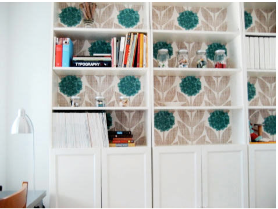 This wallpaper totally transformed these Ikea bookshelves.  {Via  Design Sponge }