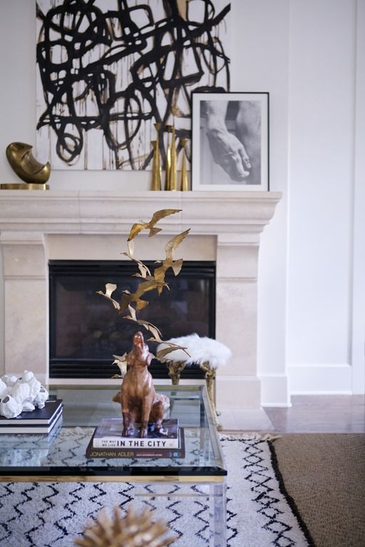 You don't need color.  Mix your black and white piece with lots of different elements - metals, furs, shiny matte, glass, etc.  It creates a striking vignette.  {Via Pinterest}