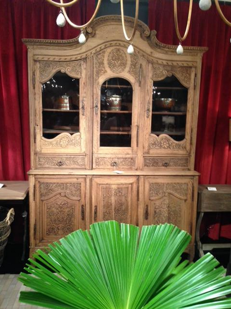 Sorry this image is not the best. This storage hutch is a French antique with hand carved details.
