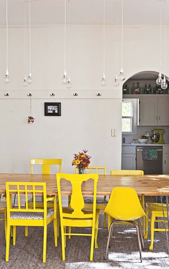 This yellow is so cheerful and I love the way it unifies this grouping of mismatched chairs.  {Via  Apartment Therapy }