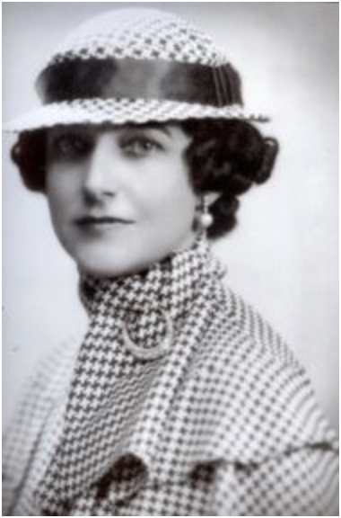 Dorothy Draper, one of the most famous American interior decorators, sports a classic houndstooth print in this this photo taken in the early 1930's.  Photo from the archives of Dorothy Draper & Co.
