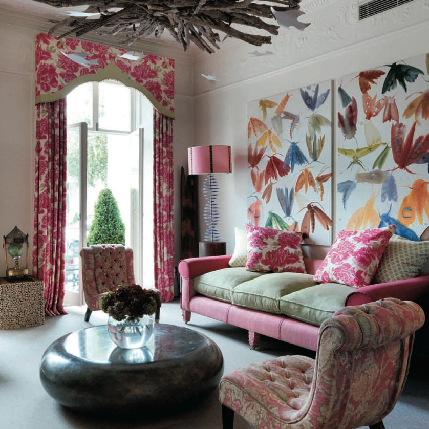 One fabric on the outside frame and one fabric on the cushions.  And what fun colors!  {Via  Kit Kemp's Number Sixteen Hotel }