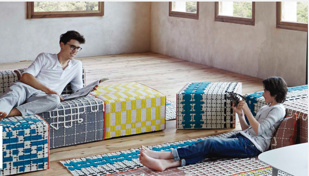 A mix of rug covered poufs by this super cool Spanish company that deserves its own blog post {Via  Gan-Rugs }