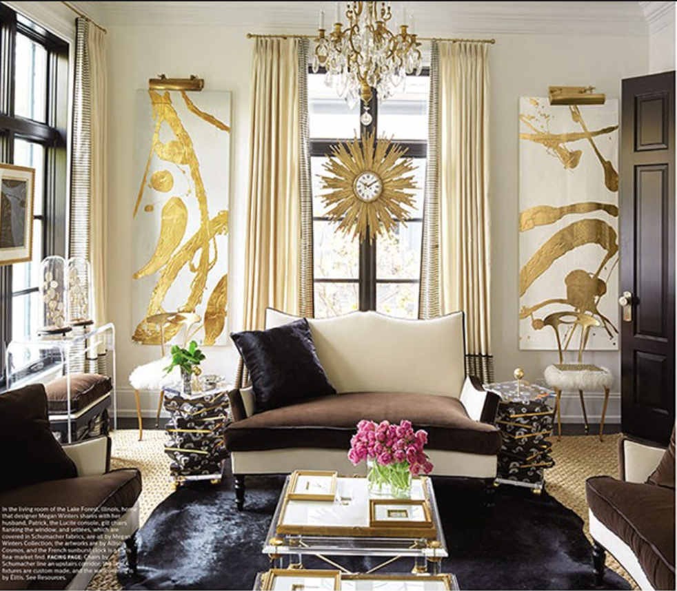 I just love this sunburst clock!  What I love even more is the way they've hung it in front of a window and surrounded it by beautiful gold abstract paintings by artist  Allison Cosmos  {Via Elle Decor}