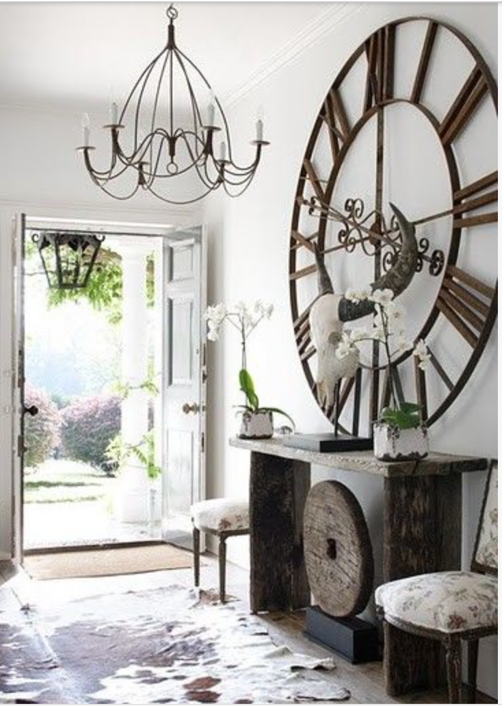 This has to be in Texas... Skulls, cowhides, and a giant, rustic, iron clock (everything is bigger in Texas) {Via Pinterest}