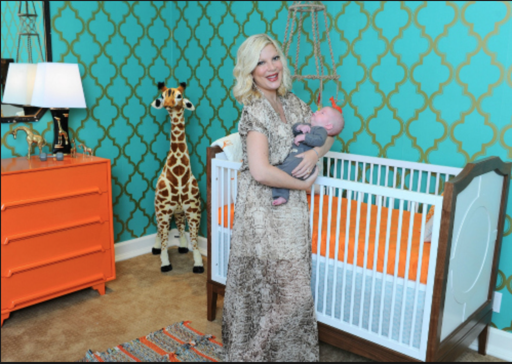 Tori Spelling's son's super cute nursery with Tempaper Marrakesh Honey Jade Wallpaper.