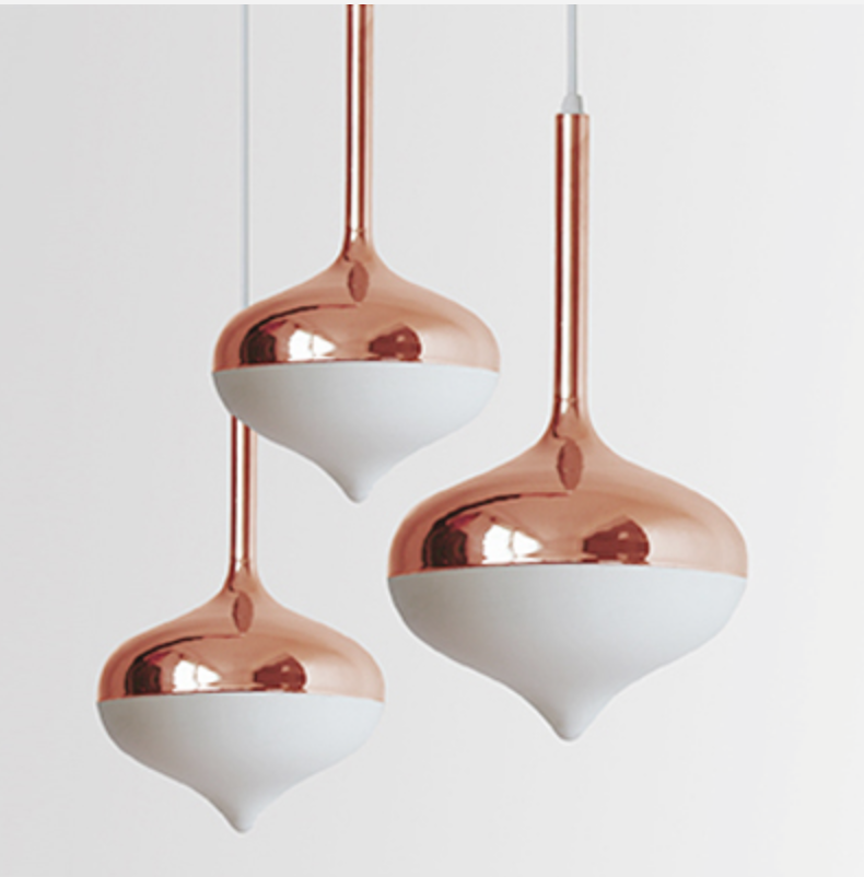 This pendant was inspired by the classic wooden spinning top toy.   Spun Pendant Lights in Rose Gold  by Australian design group, Evie Group.